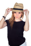 Teen rebellious girl with a straw cap Royalty Free Stock Photography