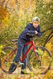 Teen on red bike Royalty Free Stock Image