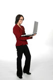Teen in red business jacket with laptop. Teenage girl wearing a red business jacket and holding a laptop Stock Photos