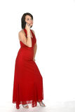 Teen in red gown on phone Stock Images