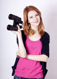 Teen redhead girl with binoculars Stock Photo