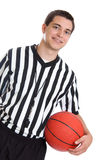 Teen referee with basketball Royalty Free Stock Image