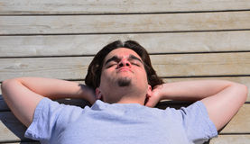 Teen relaxing on deck Stock Images