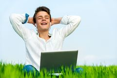 Teen relaxing outdoors with music. Royalty Free Stock Image