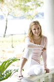 Teen relaxing on sunny porch Royalty Free Stock Images