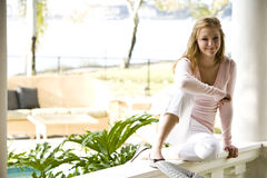 Teen relaxing on sunny porch Stock Photography