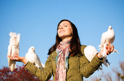 Teen releasing a pigeons Stock Images