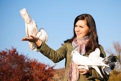 Teen releasing a pigeons Stock Photo