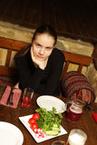Teen in restaurant Stock Photography