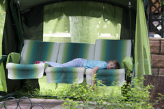 Teen resting on bedstone Stock Photos