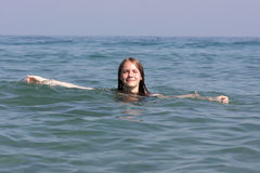 Teen rests in the sea Royalty Free Stock Photo