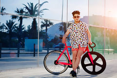 Teen rides a bike in the bright summer day Stock Images