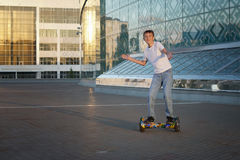 Teen rides a gyroscooter, with a smile and positive emotions Stock Photos