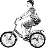 Teen riding a bicycle Royalty Free Stock Image