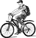Teen riding a bicycle Stock Images