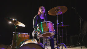 Teen rock music - attractive girl percussion drummer perform music break down. Horizontal Stock Photo
