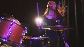 Teen rock music - girl with flowing hair percussion drummer performing with drums. Close up Royalty Free Stock Photo