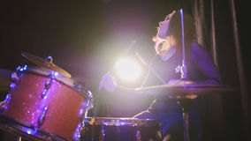 Teen rock music - girl with flowing hair percussion drummer performing with drums. Close up Royalty Free Stock Images