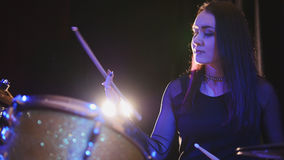 Teen rock music - gothic girl percussion drummer perform music break down. Telephoto Royalty Free Stock Image
