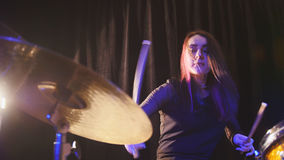 Teen rock music - gothic girl percussion drummer performing with drums. Close up Stock Image