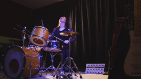 Teen rock music - Passionate dashing girl percussion drummer perform music break down. Wide angle Royalty Free Stock Photos