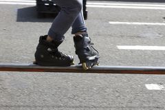 Teen with roller skates performing a stunt on a half pipe ramp. Sport Royalty Free Stock Image