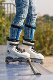 Teen with roller skates ready for a stunt on a half pipe ramp Stock Images