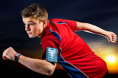 Teen runner ready to run with smart app. Royalty Free Stock Image