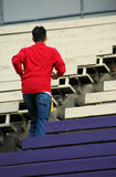 Teen Running. Up some bleachers in a stadium royalty free stock photo