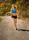 Teen running in countryside Royalty Free Stock Photos