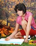 Teen's Art in an Autumn Park Stock Image