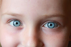 Teen's blue eyes staring up Stock Photo