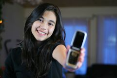 Teen's first cell phone. Stock Photos