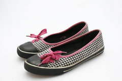 Teen's shoes. A pair of black and white checkered shoes with pink shoelaces Royalty Free Stock Images