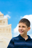 Teen at the sand castle Royalty Free Stock Images