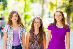 Teen schoolgirls walking in the park Stock Images