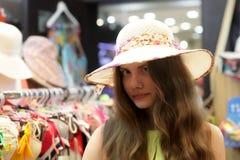 Teen at shop hats Royalty Free Stock Images