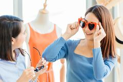 Free Teen Shopping, Girl Teen Trying And Buying Cute Fancy Heart Shaped Sunglasses Happy Enjoy Shopping With Friends Stock Image - 171781891