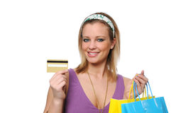 Teen shopping showing a credit card Royalty Free Stock Photos