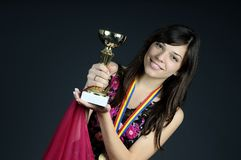 Teen showing golden cup Royalty Free Stock Images