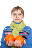 Teen Shows oranges. The child has a sore throat. He tied a warm scarf Stock Photos