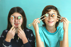 Teen siblings boy and girl kids with sushi rolls Stock Photo