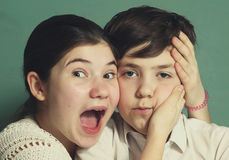 Teen siblings brother and sister grimacing Royalty Free Stock Photos