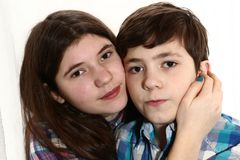 Teen siblings younger brothe and elder sister hug Stock Photography
