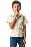 Teen silence sign finger over mouth Stock Photography