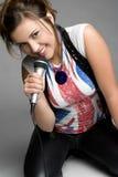 Teen Singer. Beautiful pretty teen girl singer Stock Photo