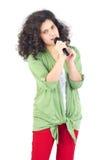 Teen singing in studio Royalty Free Stock Photo
