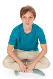 Teen sits on the floor Stock Photo