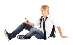 Teen sitting on floor Stock Photo