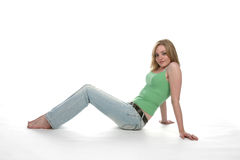 Teen sitting and leaning back on her arms royalty free stock photography